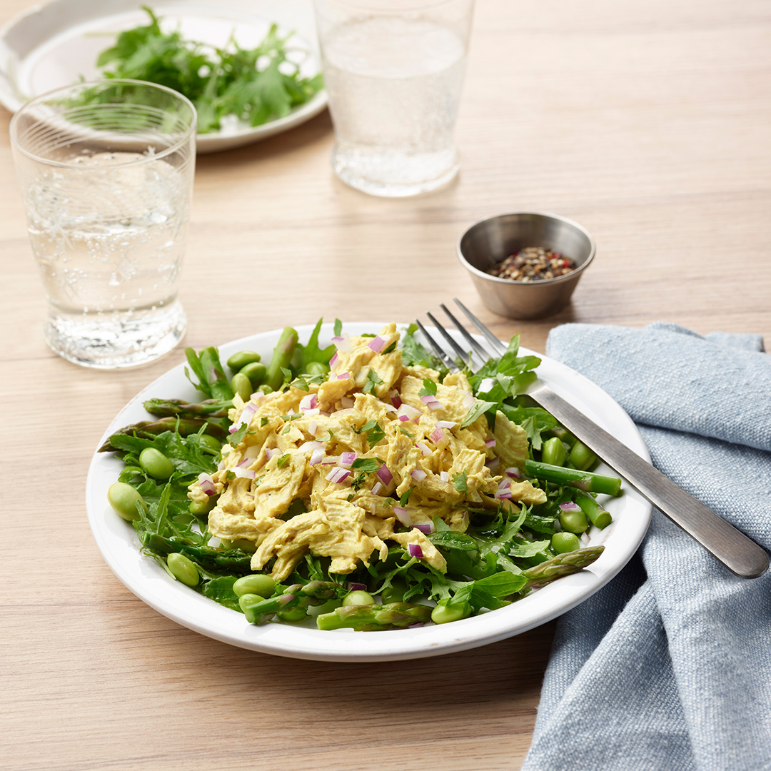 Chicken Curry Salad On Asparagus Edamame And Greens